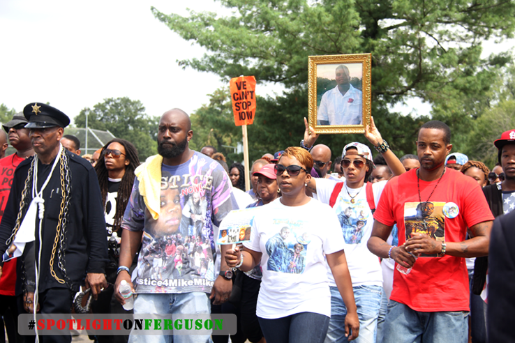 Mike Brown's family marches in Labor Day Weekend rally, backed by thousands of protestors, including several hundred from #BlackLivesMatter, who come from around the country to support. (Ferguson)
