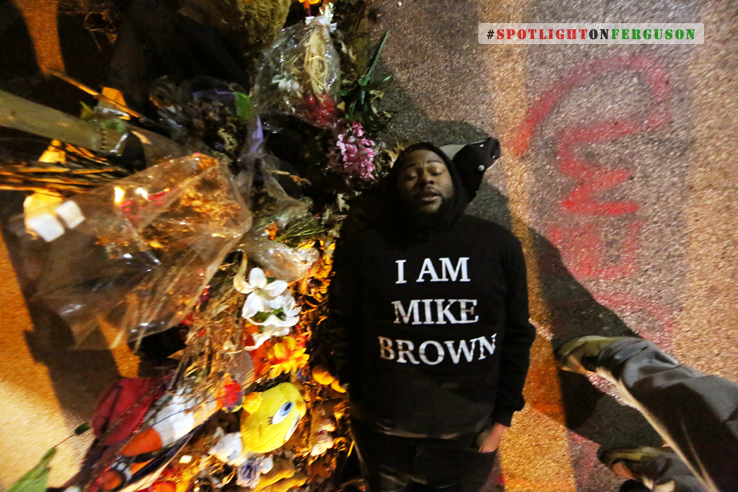 Just moments before the Grand Jury announcement, a man lays down in the middle of the street where Mike Brown was murdered (Ferguson)
