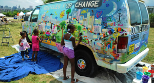 Young West Baltimore residents paint a Vehicle for Change during ROOTS Fest 2011.