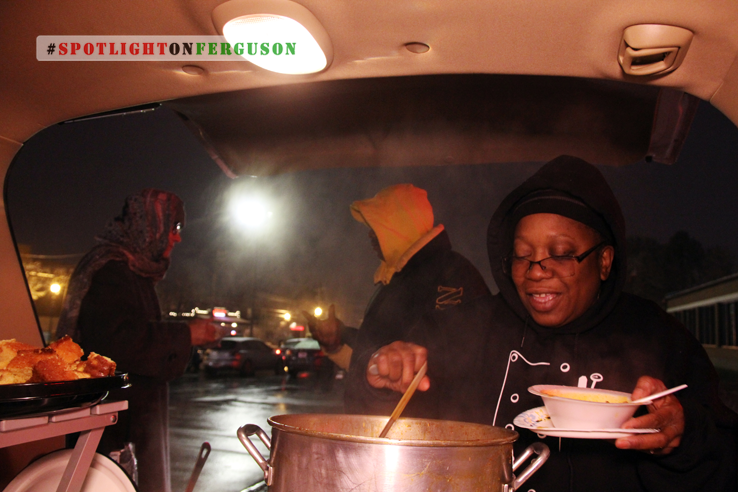 "Mama Cat aka ""Cadillac"" feeds her protest family across the street from the Ferguson Police Department, every Sunday at 4pm. (Ferguson). Photo: Katina Parker"