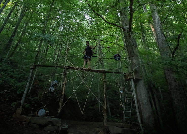 Spider Mirra Shapiro and her web set in the woods at Clear Creek. Photo: Melisa Cardona, 2014.