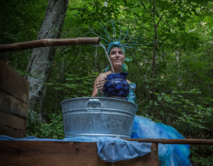 Carrie offers water from the Clear Creek spring. Photo: Melisa Cardona, 2014.
