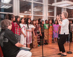 Elise Witt directs students from the Global Village Project. Photo: JourneyBrave, 2014.