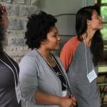 Scholars, Michelle Gomez, Angela Davis Johnson, and Jessica Caldas take in the space.