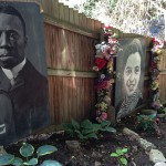 Portraits of Black Revolutionaries line the perimeter of the garden.