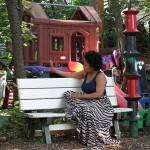 Joan Mitchell Visual Arts Scholar Angela Davis Johnson reflects in Barton's Peace Garden.