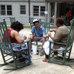 Angela Davis Johnson, Muthi Reed and Sage Crump share lunch on the rockers.