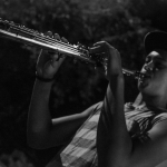 Logan Murray, playing his saxophone at ROOTS Week Late Night. Photo: Peter Eversoll, 2015.