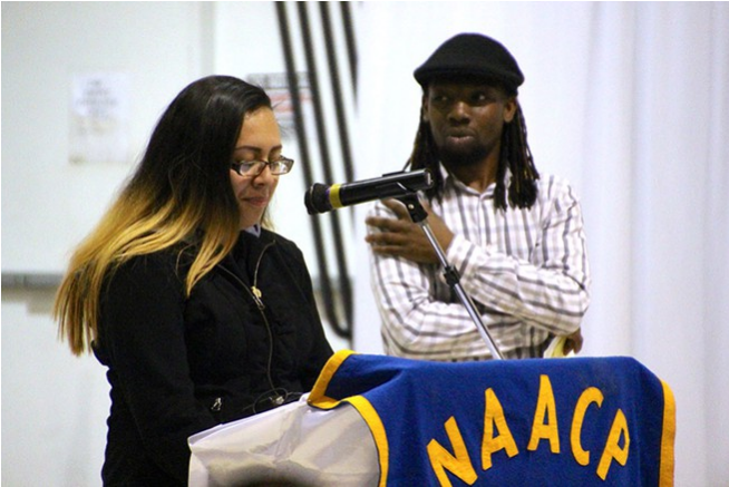 Karla presenting at an NAACP meeting about policing in North Charleston. Photo by Dustin Waters