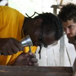 A growing movement of international artists are coming to spend time in residency at Azule. Stoneworker Phinias Chirubvu from South Africa came and led a stone carving workshop called Words in Nature in 2012. (Photo: Azule Archives)