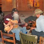 Local troubadours jam bluegrass tunes at the Fall Back in Time yearly Azule potluck in 2013.